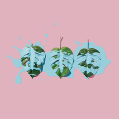 Obraz na SzkleBlue paint splatter over tropical leaves on pink pastel background. flat lay. Minimal concept.