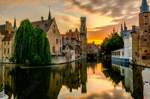 Foto op Canvas Brugge Bruges (Brugge) cityscape with water canal at sunset