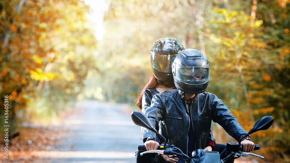 Fototapeta couple biker riding motorcycle