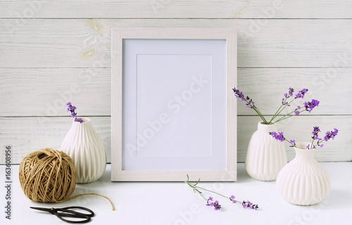 White Frame Mockup With Lavender Flowers In White Vases Copy Space