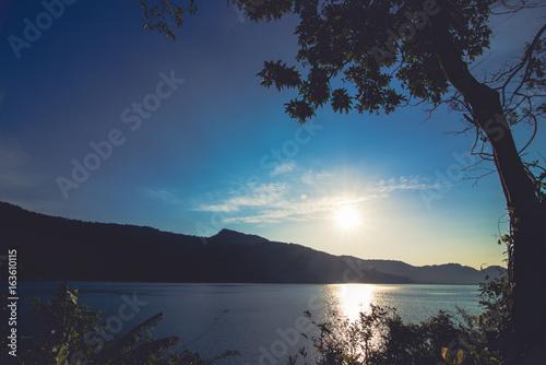 Fotobehang Volle maan Sunset behind the mountain