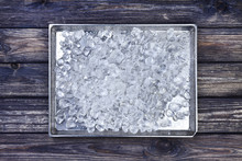 Crushed Ice On Tray On Dark Wooden Background. Copy Space, Top View