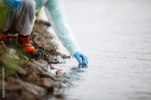 Photo  Laboratory assistant takes water samples