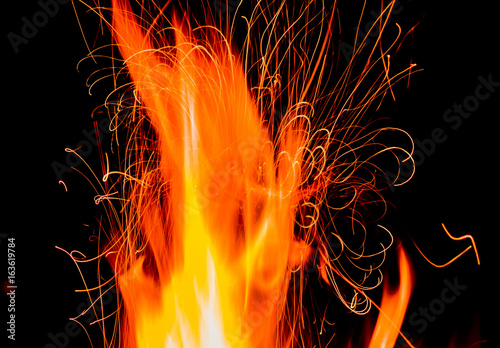 Fotografie, Tablou Fire and Sparks on a Black Background