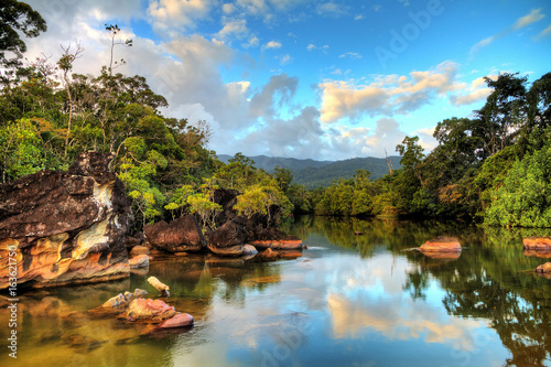 Fotografie, Obraz  Beautiful view of the tropical jungle river at the beach of Masoala National Par