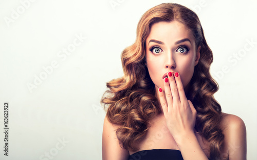 Shocked and surprised girl  presenting  your product Canvas Print