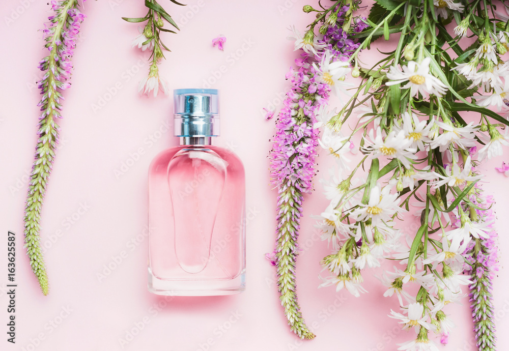 Fototapety, obrazy: Floral perfume bottle with fresh herbs and flowers on pink background, top view.  Beauty concept