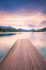 Naklejka Wooden deck leading into Bled lake,Slovenia