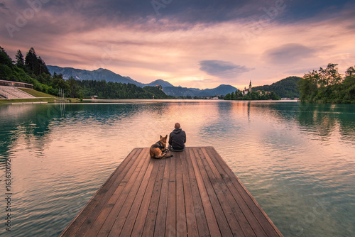 Recess Fitting Deep brown Man and dog sitting on wooden deck at Bled lake, Slovenia