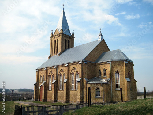 Staande foto Praag Neo-Gothic church, side view. Church of the Assumption of the Virgin Mary. Belarus