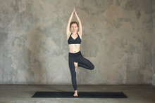 Young Woman Practicing Yoga Tr...