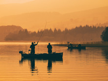 Silhouette Of Man Fishing On L...