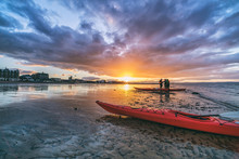 Kayaks And Kayakers On Beach A...