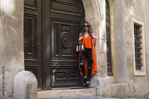 Elegant woman with hand bag and sunglasses Poster