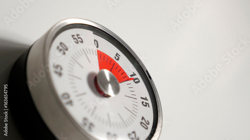 Classical vintage kitchen countdown timer close up shot with