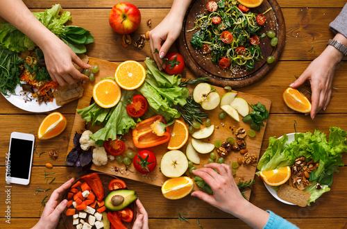 Foto op Canvas Eten Dinner table, women eat healthy food at home kitchen