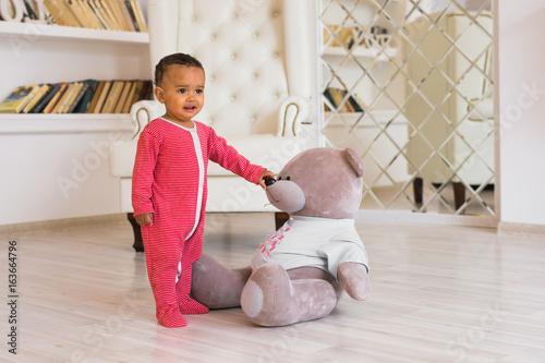 Fototapeta Happy baby boy playing with his teddy bear obraz na płótnie
