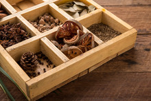Assorted Dried Herbs In A Printers Tray With Focus To Chamomile Flowers And A Blend Of Mixed Herbs For Use In The Kitchen To Season And Flavour Food.