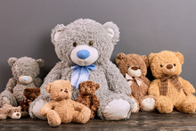 Teddy Bears On Wood Surface. Cute Soft Toys. Toy Buying Guide.