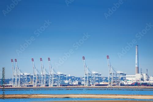 Obraz na plátně Port of Le Havre with portal cranes at sunny day