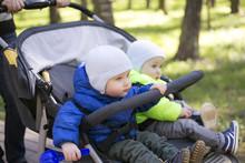 Two Boy Twins In A Stroller In...