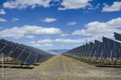 Fotografie, Obraz  Solar Panels in Power Plant with Sangre de Cristo Mountains
