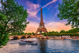 Fototapeta Paris - Paris Eiffel Tower and river Seine at sunset in Paris, France. Eiffel Tower is one of the most iconic landmarks of Paris.