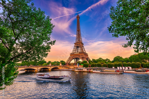 Poster Central Europe Paris Eiffel Tower and river Seine at sunset in Paris, France. Eiffel Tower is one of the most iconic landmarks of Paris.