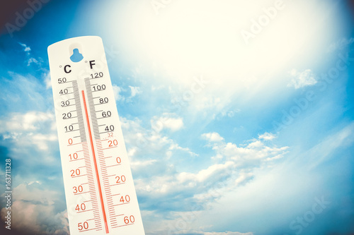 Fotografie, Obraz  Tropical temperature, measured on an outdoor thermometer, global heat wave, environment concept