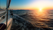 Sunset From The Deck Of The Sailing Boat Moving In A Sea.