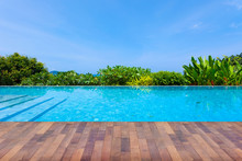 Swimming Pool Overlooking View Andaman Sea Mountains And Blue Sky Background,summer Holiday Background Concept.