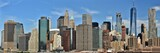Fototapeta Nowy Jork - The Freedom Tower, Wall Street, and the skyline of downtown Manhattan from New York Harbor.