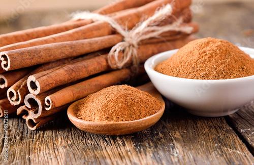 Canvas Prints Condiments Cinnamon powder on table wooden