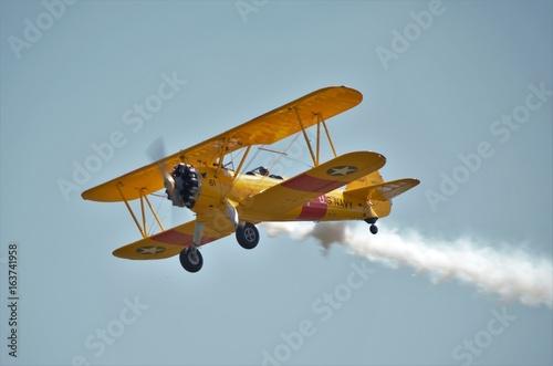 Yellow biplane airshow Canvas Print