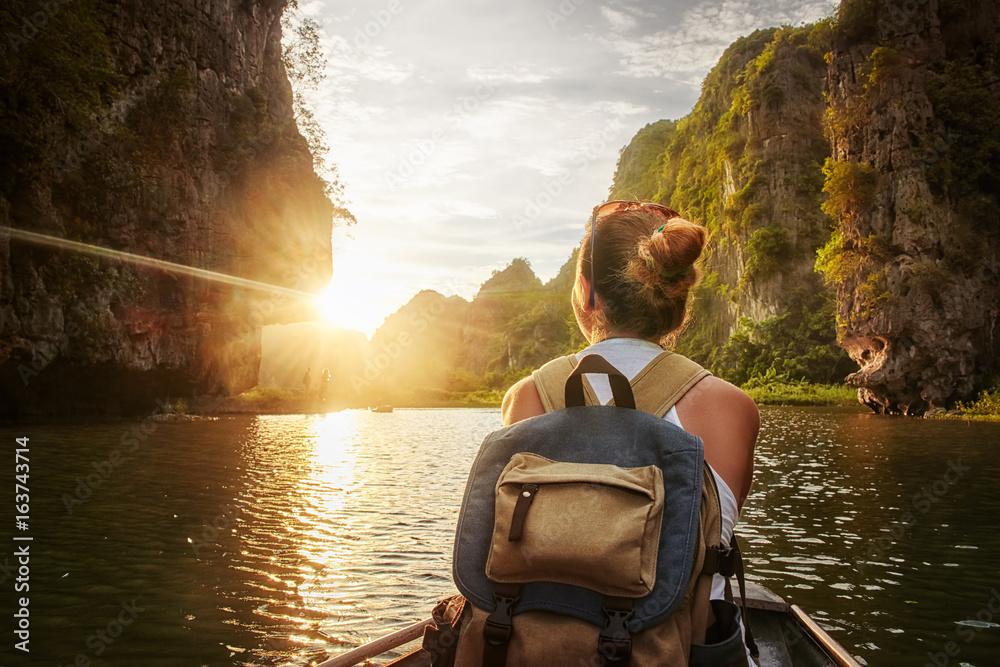 Fototapety, obrazy: Woman traveling by boat enjoying sunset among of karst mountains
