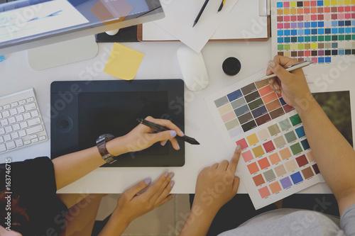 Fototapeta Designers working concept.  Team of Designers working at office. Designers Brainstorming. obraz na płótnie