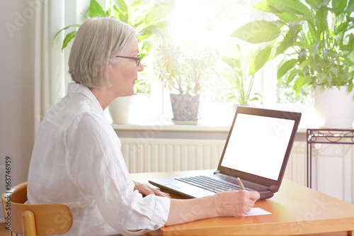 senior woman laptop blank screen