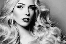 Portrait Of A Beautiful Young Girl With Luxurious Light Curly Hair. Blonde - Long Wavy Ringlets. Cosmetics For Hair, Care, Spa. Makeup - Dark Lips, Arrows. Black And White Image.