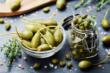 Mixed Capers In Jar And Bowl O...