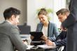 Businessmen and women having office meeting
