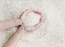 Female Hand Scooping Raw White Jasmine Rice Over Texture Pattern Background, The New Soft Rice Grain Grown In Thailand (southeast Asian Country) Good For Cooking Asian Dishes (selective Focus)
