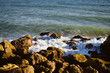 Natural sunny rocky shore outdoors seascape. Coastline abstract background
