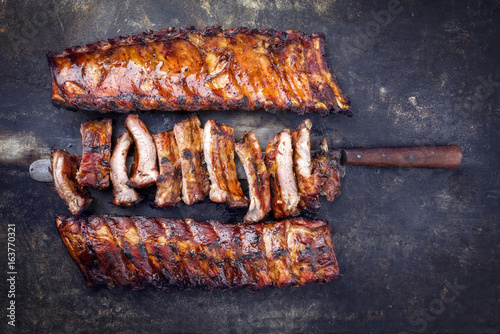 Foto op Plexiglas Grill / Barbecue Barbecue Pork Spare Ribs as top view on an old rusty metal sheet