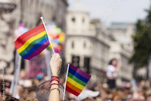 Fotografia A spectator waves a gay rainbow flag at an LGBT gay pride march in London