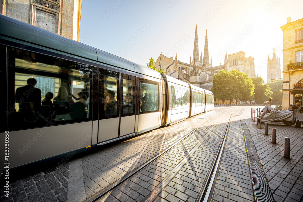Fototapety, obrazy: Morning street view with tram and saint Pierre cathedral in Bordeaux city, France