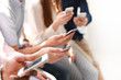 Group of students watching smartphones. Young people addiction to new technology trends.