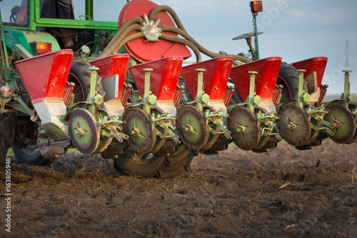 Fotografie, Obraz  Seeder for sowing attached to tractor on soil