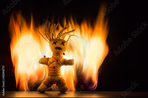 Fotografie, Obraz  A voodoo doll stands in front of a fire