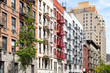 Block of colorful old apartment buildings in the East Village of Manhattan New York City