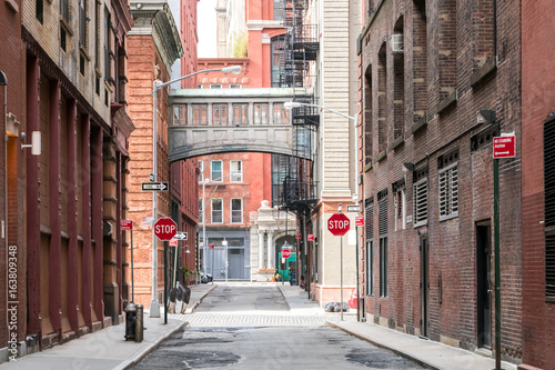 Photo Stands New York Buildings at the intersection of Staple Street and Jay Street in the historic Tribeca neighborhood of Manhattan, New York City NYC